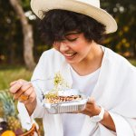 Portrait Of Beautiful Smiling Girl In Hat And White Shirt Eating 1.jpg