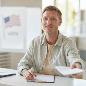 Smiling Man At Voting Station.jpg